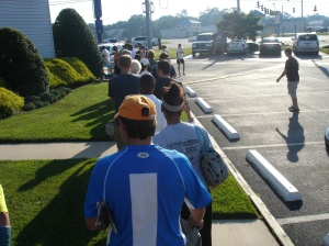 "People standing in line, ""way too rich guy"" in the blue shirt."